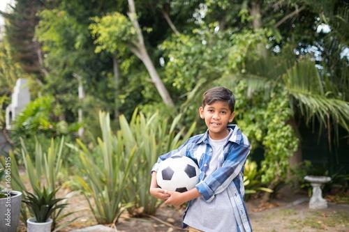 Portrait of boy holding soccer ball