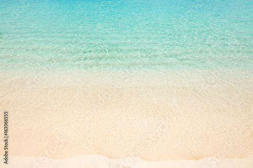 Calm tropical beach with turquoise water - 163066555