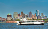 Ferry connecting New York City, Liberty and Ellis Islands and Jersey City - 163070737