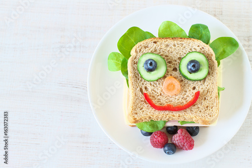 Healthy and fun food for kids , happy and funny face sandwich - 163072383