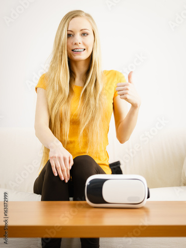 Poster Happy young woman next to VR