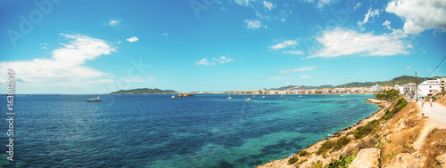 Fotobehang Blauw rocky coast Balearic Island, Ibiza, Figueretas Panorama