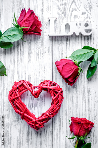 concept Valentine's Day with flower wooden background top view
