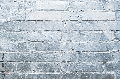 brick  wall  painted in silver, graffiti background