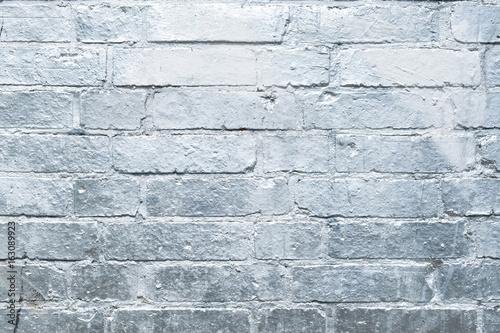 Poster Graffiti brick wall painted in silver, graffiti background