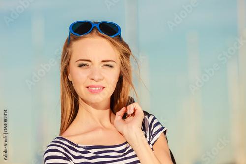 Girl enjoying summer breeze outdoor in marina