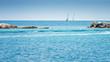 Two sailboats at sea near the island of Paxos, Greece, Europe.