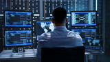 System Security Specialist Working at System Control Center. Room is Full of Screens Displaying Various Information. - 163119167