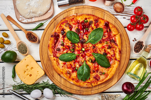 Big baked pizza, vegetables, dough.