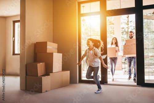 Leinwandbild Motiv Family moving in new house