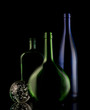 Still life of glass bottles on a black background