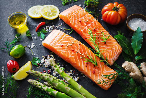 Fresh salmon fillet with aromatic herbs, spices and vegetables - 163132366