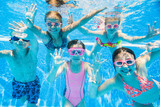 little kids swimming  in pool  underwater. - 163138124