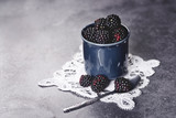 Delicious blackberries in the retro cup - 163141960