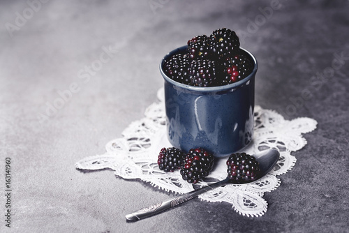 Delicious blackberries in the retro cup