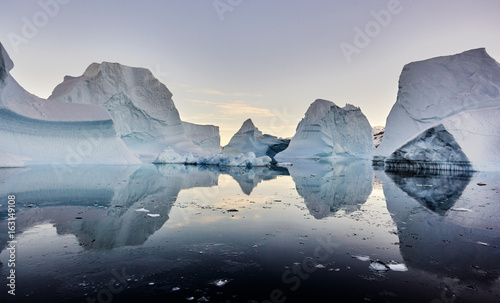 iceberg floating in greenland fjord