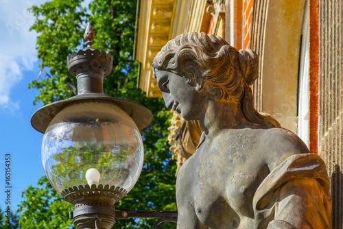 berlin, postdam, new palace :woman statue and street lamp