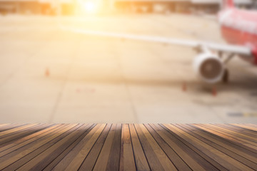 wooden floor for your text or object and blurred airplane in the background.