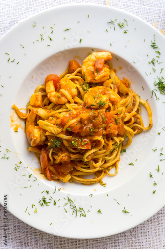 close-up of plate of pasta and Shrimp with lettuce