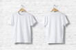 Blank White T-Shirts  Mock-up hanging on white wall, front and rear side view . Ready to replace your design