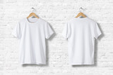 Fototapety Blank White T-Shirts  Mock-up hanging on white wall, front and rear side view . Ready to replace your design