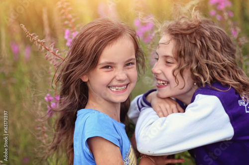 Two joyful and happy young friends - 163170397