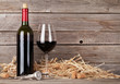 Red wine bottle and wine glass - 163174126
