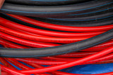 Water garden and high pressure hoses red, black and blue colors. Close-up.  - 163174530