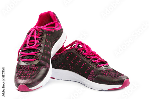 Tuinposter Gymnastiek Stylish pink sneakers isolated on white background