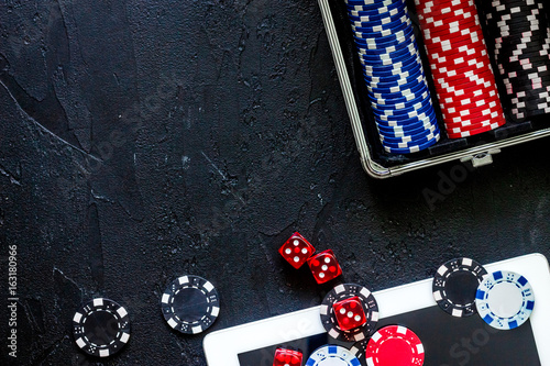 Poker set in a metallic case on a grey table top view copyspace плакат