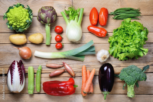 Stampa su Tela Selection of raw vegetables on wood background