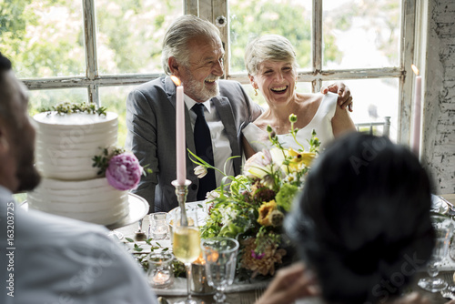 Senior Caucasian Couple Sitting Together Cheerful
