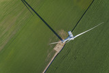 Wind turbine in a green field, top aerial view - 163208328