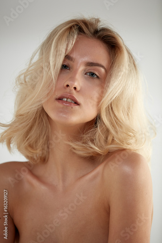 Closeup portrait of a caucasian nude blonde