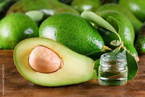 Fresh ripe green avocados and natural avocado oil. Home spa