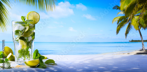 tropic summer vacation; Exotic drinks on blur tropical beach background - 163212505