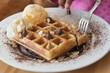 waffles with chocolate sauce and ice cream