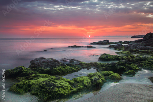 Stones at sunset in the sea Poster