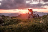 Male mountainbiker at sunset in the mountains - 163227765