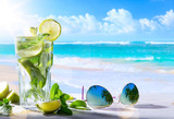 tropic summer vacation; Exotic drinks on blur tropical beach background - 163234331
