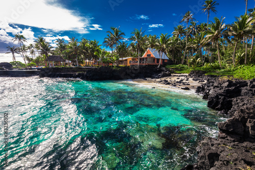 Coral reef and small beach with palm trees on south side of Upolu, Samoa