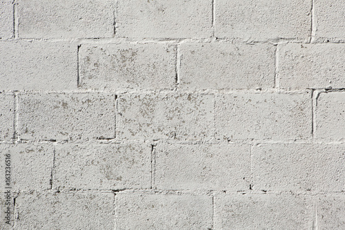 Whitewashed brick wall.