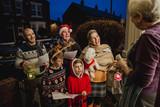 Family Carol Singing - 163238930