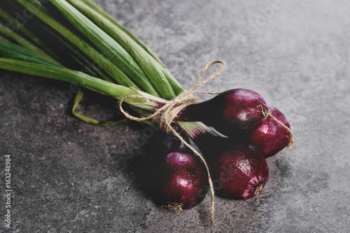 Stack of fresh young onions