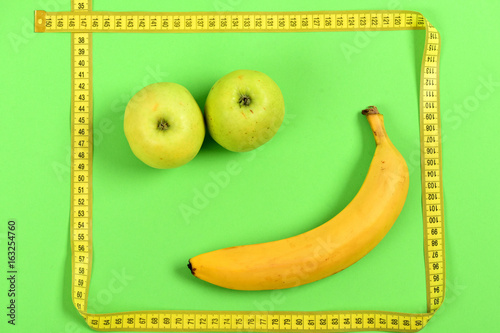 Funny smiley made of food: apples and banana with tape - 163254760