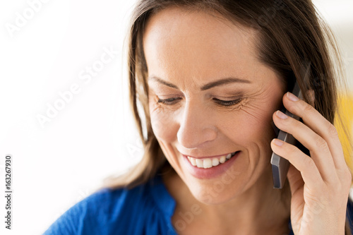 close up of happy woman calling on smartphone