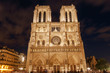 view on front side of Notre-Dame de Paris Cathedral at night
