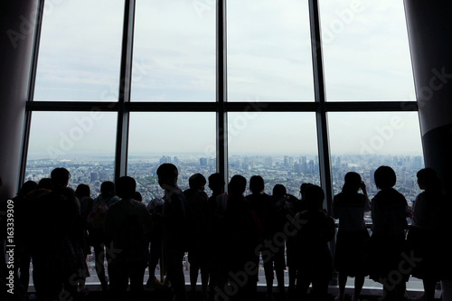 Sticker Silhouette of sightseeing people with Japan cityscape background