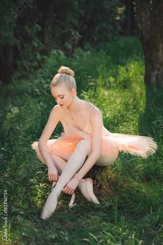 Young ballerina preparing for dance outdoors