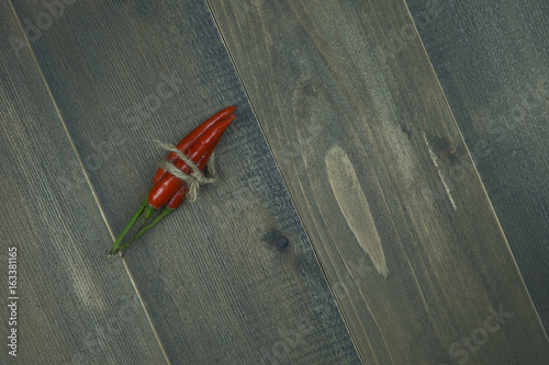 red chili pepper on wooden table